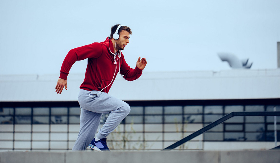 Man running with on-ear sport headphones
