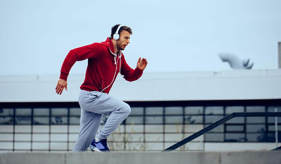 Man running with on-ear sport headphones