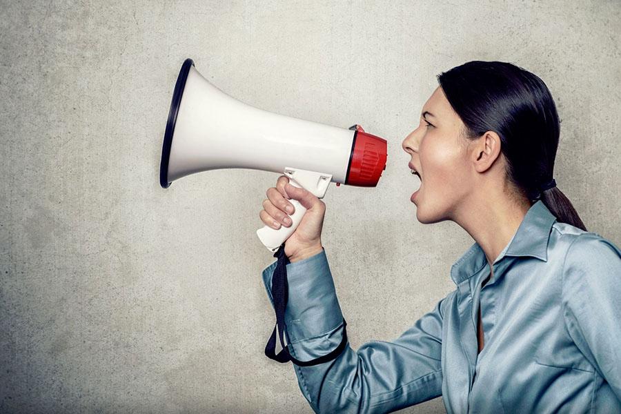 woman-talking-to-a-megaphone-making-noise