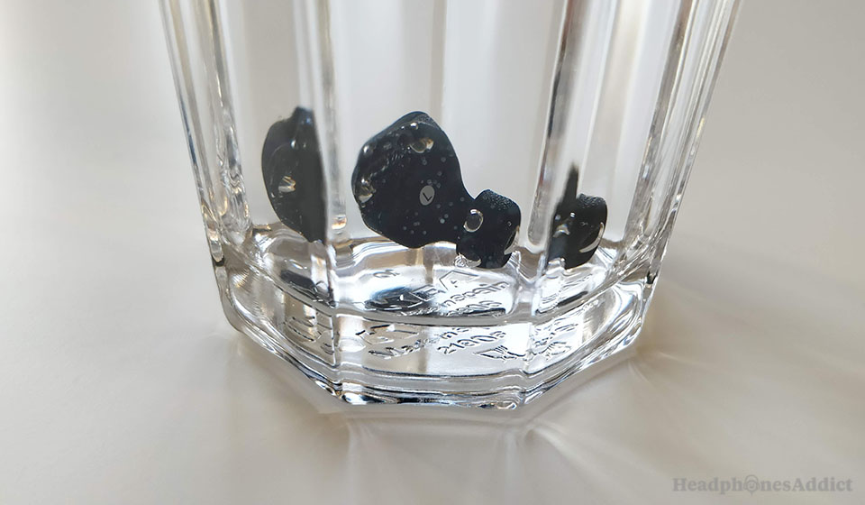 xFyro Aria true wireless earbuds in a glass of water