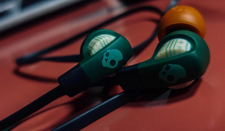 Skullcandy green and orange earbuds