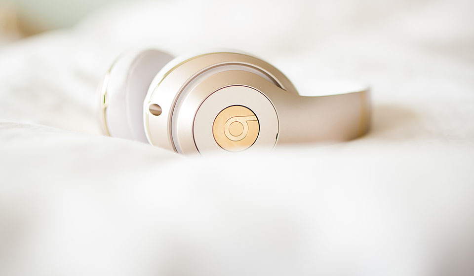 gold Beats by Dre headphones