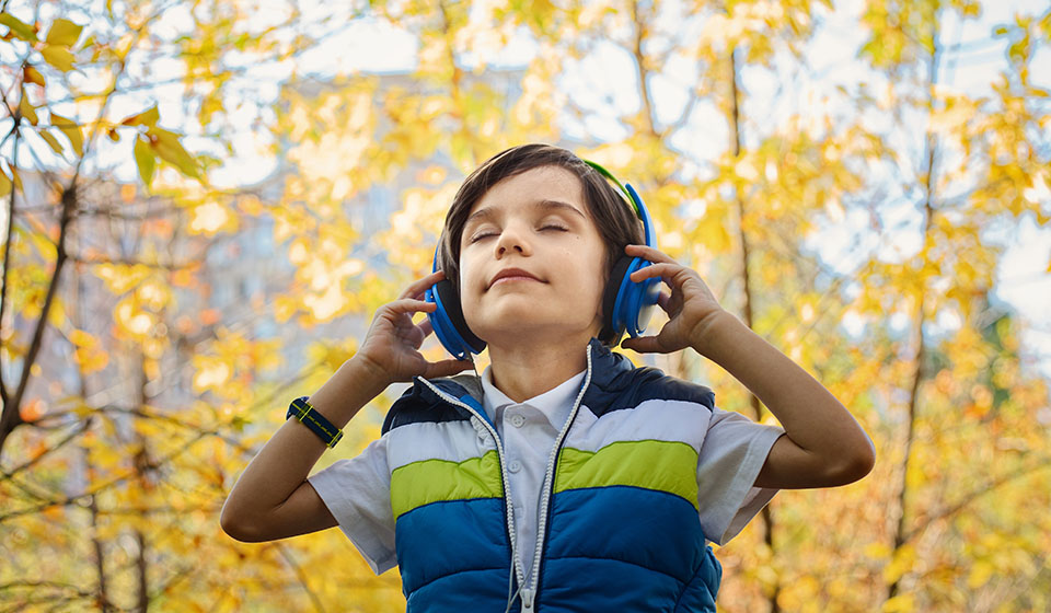 kid wearing noise isolating headphones