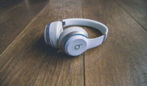 Closed-back headphones have superior noise isolation including all Beats headphones.