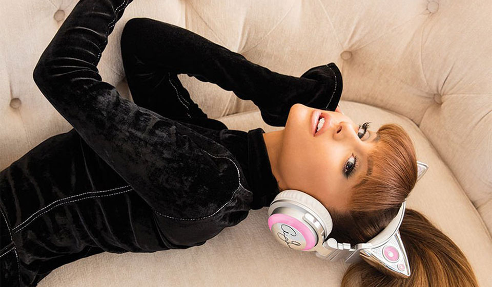 Ariana Grande with her famous cat ear headphones.