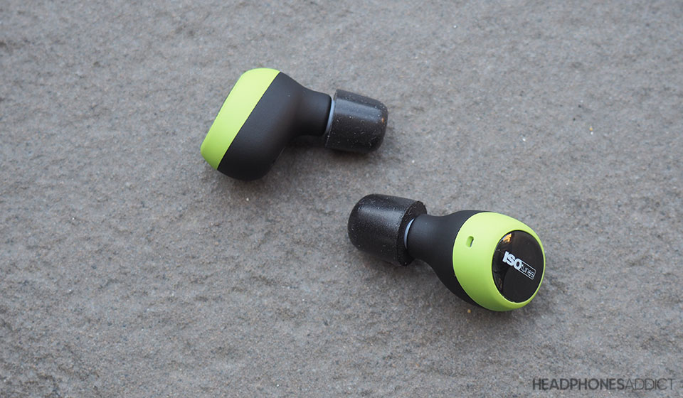 ISOtunes Free green earbuds on grey surface