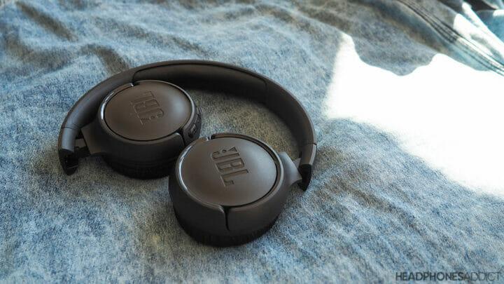 JBL Tune 500BT wireless headphones on jeans