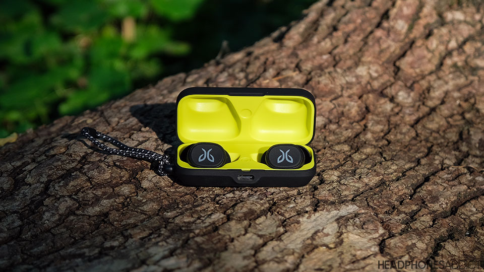 Jaybird Vista true wireless earbuds on a wooden log