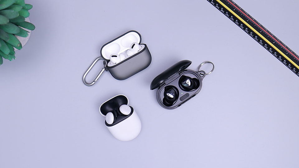 Three true wireless earbuds on the table