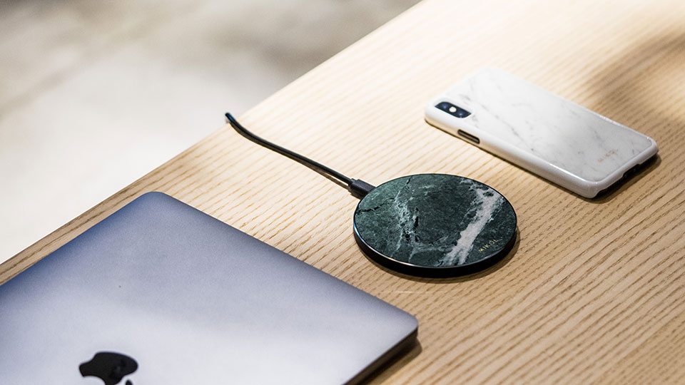 Wireless charging pad with MacBook and iPhone