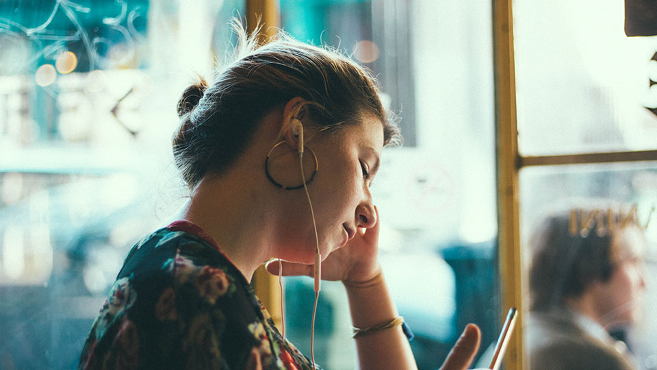 Woman with earbuds