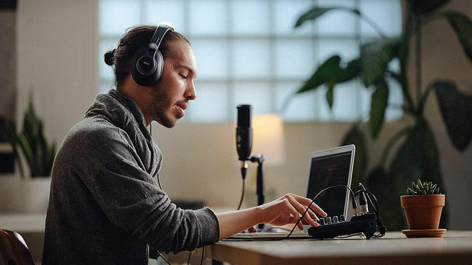 Man listening to AKG K371-BT