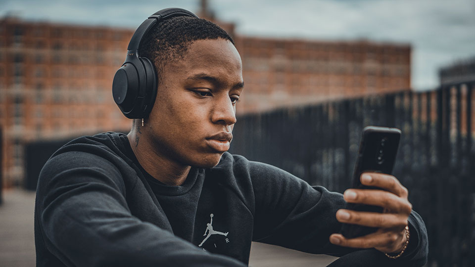 Guy listening to Sony headphones