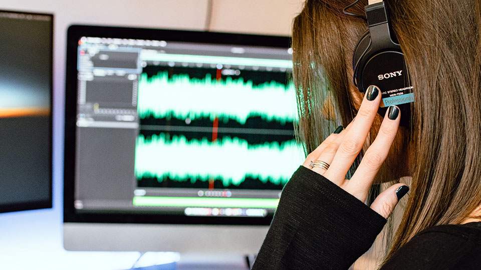 Woman in studio wearing headphones